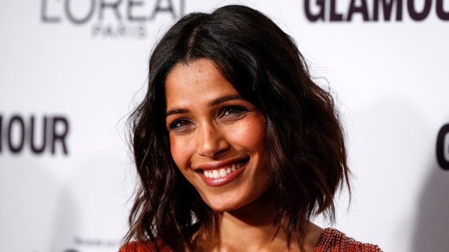 Actress Freida Pinto arrives for Glamour Magazine's annual Women of the Year award ceremony in New York November 10, 2014.  REUTERS