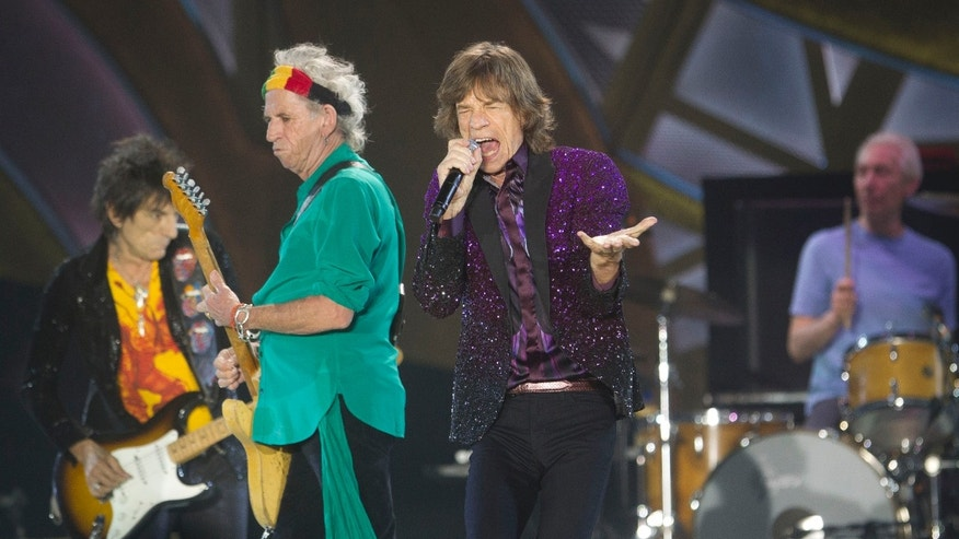 FILE - In this June 4, 2014, file photo, Rolling Stones singer Mick Jagger, performs with Keith Richards, second left, Ronnie Wood, left, and drummer Charlie Watts during a concert in Hayrkon Park in Tel Aviv, Israel. The Stones will kick off a 15-city stadium tour of North America on May 24 at Petco Park in San Diego, Calif. (AP Photo/Ariel Schalit, File)