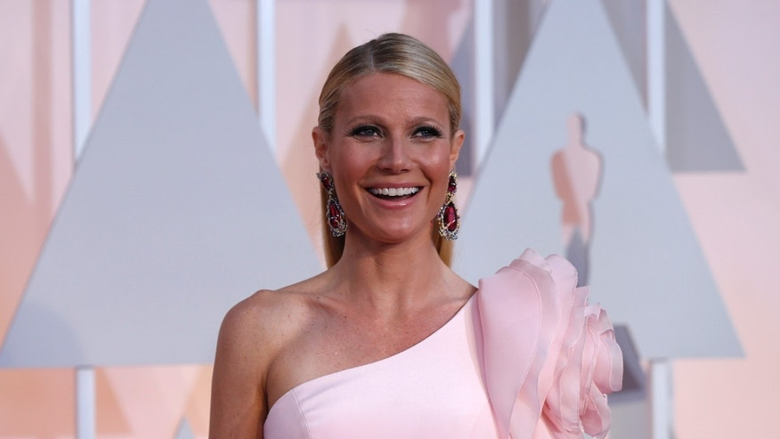Feb 22, 2015. Actress Gwyneth Paltrow, wearing a custom Ralph & Russo pink one sleeve gown with a giant flower on the shoulder, arrives at the 87th Academy Awards in Hollywood, California.