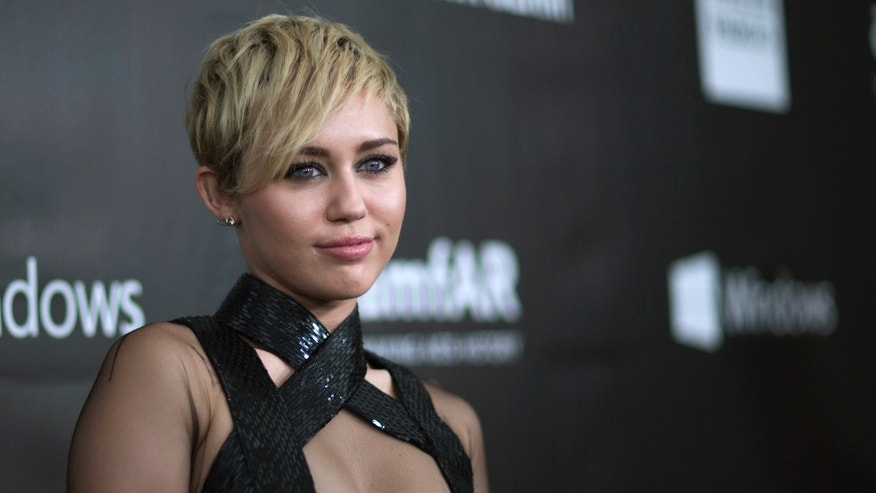 October 29, 2014. Singer Miley Cyrus poses at the amfAR's Fifth Annual Inspiration Gala in Los Angeles, California.