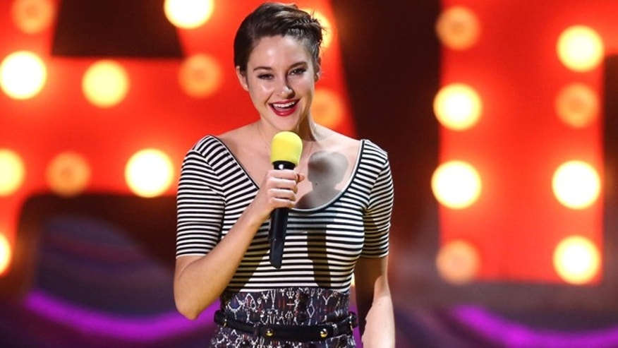 April 12, 2015: Shailene Woodley accepts the trailblazer award at the MTV Movie Awards at the Nokia Theatre  in Los Angeles.