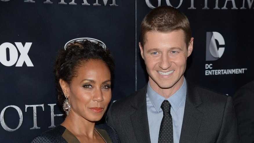 "Jada Pinkett Smith and Ben McKenzie arrive at ""Gotham"" series premiere event at the New York Library on Monday, Sept. 15, 2014 in New York. (Photo by Evan Agostiniti/Invision/AP)"