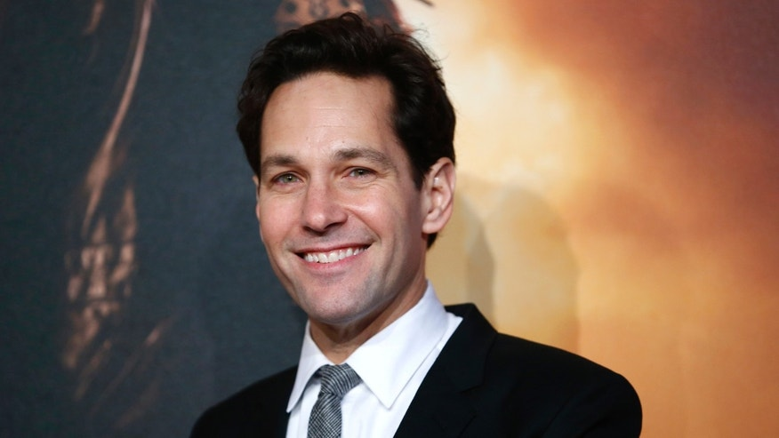 Actor Paul Rudd poses at the UK Premiere of the film Anchorman 2 in Leicester Square, London, December 11, 2013. REUTERS/Andrew Winning  (BRITAIN - Tags: ENTERTAINMENT) - RTX16E9M