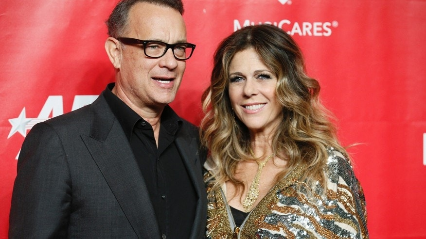 Actor Tom Hanks (L) and Rita Wilson (R) pose at the 2014 MusiCares Person of the Year gala honoring Carole King in Los Angeles, January 24, 2014.