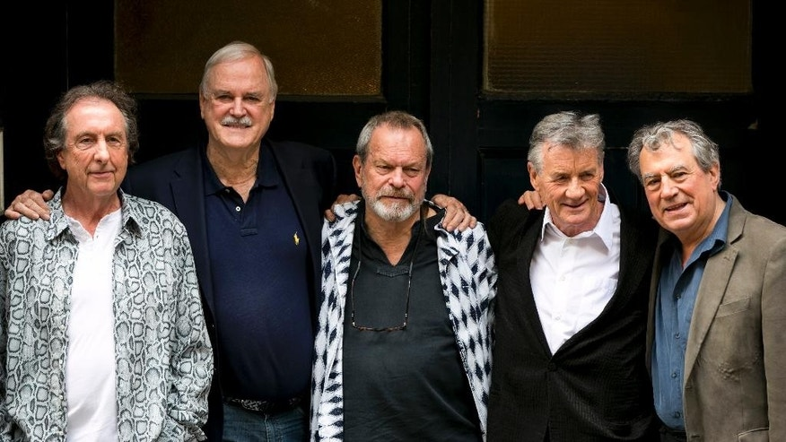 "FILE - In this June 30, 2014 file photo, from left, Eric Idle, John Cleese, Terry Gilliam, Michael Palin and Terry Jones of the comedy troop Monty Python pose for photographers during a photo in London. A 40th anniversary screening of ""Monty Python and the Holy Grail"" will take place during the Tribeca Film Festival on April 24 at the Beacon Theatre in New York. (Photo by John Phillips Invision/AP, File)"