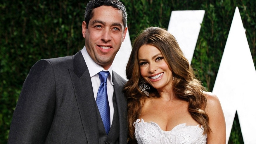 Actress Sofia Vergara and Nick Loeb arrive at the 2012 Vanity Fair Oscar party in West Hollywood, California February 26, 2012.