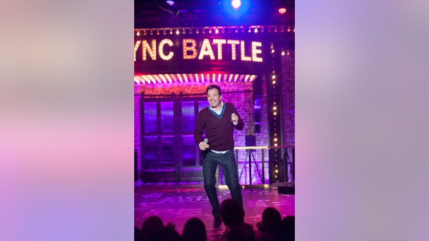 "In this image released by Spike TV, Jimmy Fallon  appears on the celebrity competition series, ""Lip Sync Battle."" When Jimmy Fallon sought to turn the popular lip sync competition feature from the ""Tonight"" show into a television series, NBC turned down one of its biggest stars _ a decision that at least initially seems like an embarrassing mistake. Fallon and his production partners instead brought ""Lip Sync Battle"" to corporate competitors at the Viacom-owned Spike TV, where it instantly became a hit. (Scott Gries/Spike TV via AP)"