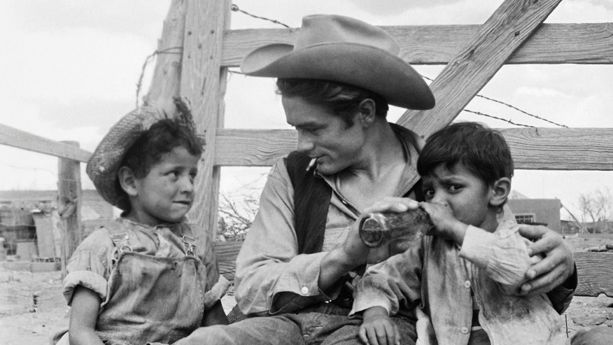 "This undated photo provided by courtesy of Richard C. Miller shows, James Dean and two local children on the set of âGiant,â in Marfa, Texas. A new documentary, ""Children of Giant,"" examines the Mexican-American child actors who appeared in the 1956 blockbuster movie âGiantâ but later were forced to view the film in segregated theaters. (Courtesy Richard C. Miller via AP)"
