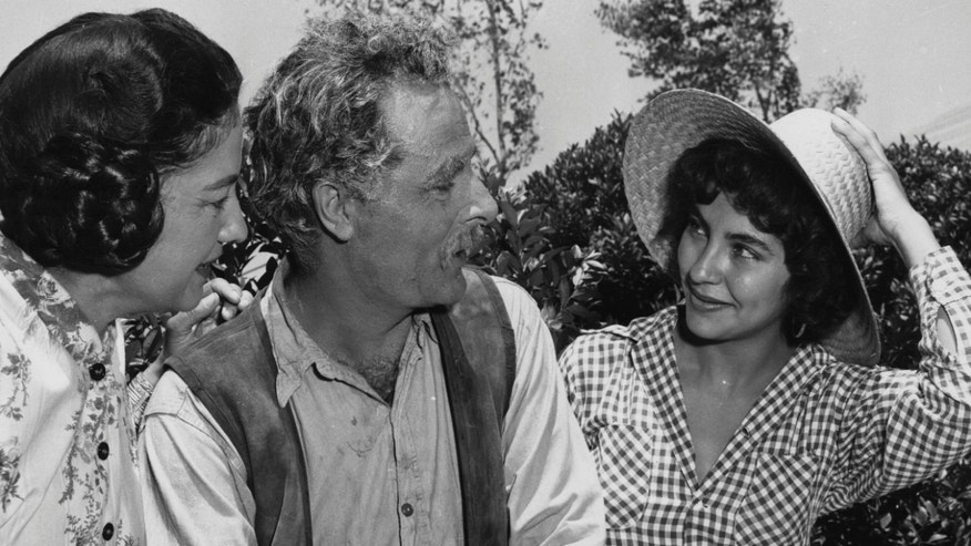 "This undated photo provided by courtesy of the George Stevens Collection shows, Elsa Cardenas, right, as the Mexican American nursing student âJuanaâ who marries âJordan Benedict,â played by Dennis Hopper, in âGiant.â A new documentary, ""Children of Giant,"" examines the Mexican-American child actors who appeared in the 1956 blockbuster movie âGiant,â but later were forced to view the film in segregated theaters. (Courtesy George Stevens Collection via AP)"
