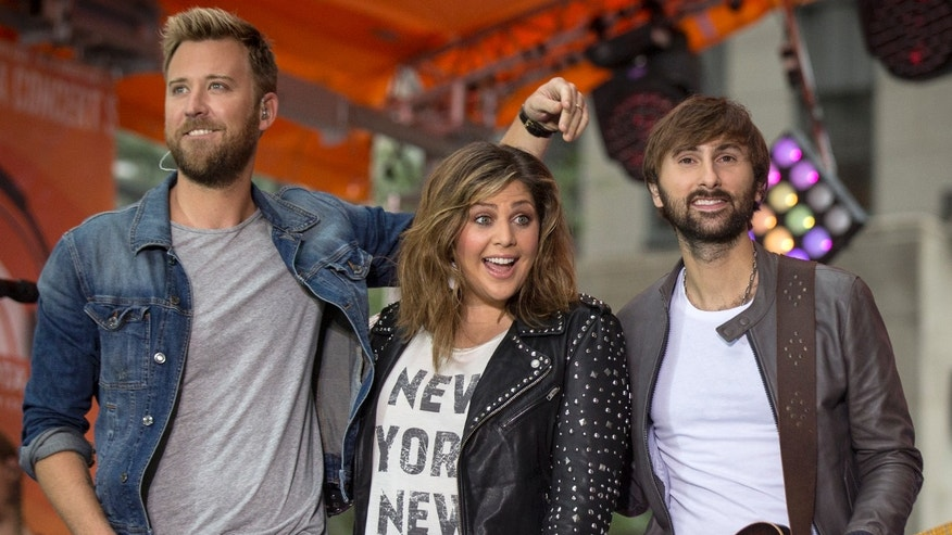 Members of country band Lady Antebellum Charles Kelley (L-R), Hillary Scott and Dave Haywood appear on NBC's 'Today' show in New York September 30, 2014. REUTERS/Brendan McDermid (UNITED STATES - Tags: ENTERTAINMENT) - RTR48DIX