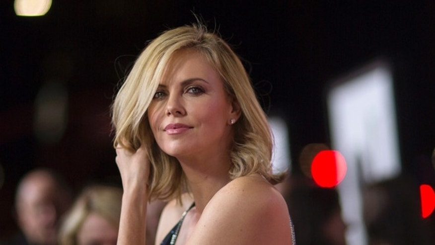 """March 12, 2015. Actress Charlize Theron attends the premiere of """"The Gunman"""" in Los Angeles, California."""