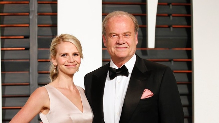 February 22, 2015. Actor Kelsey Grammer and wife, Kayte Walsh, arrive at the 2015 Vanity Fair Oscar Party in Beverly Hills, California.