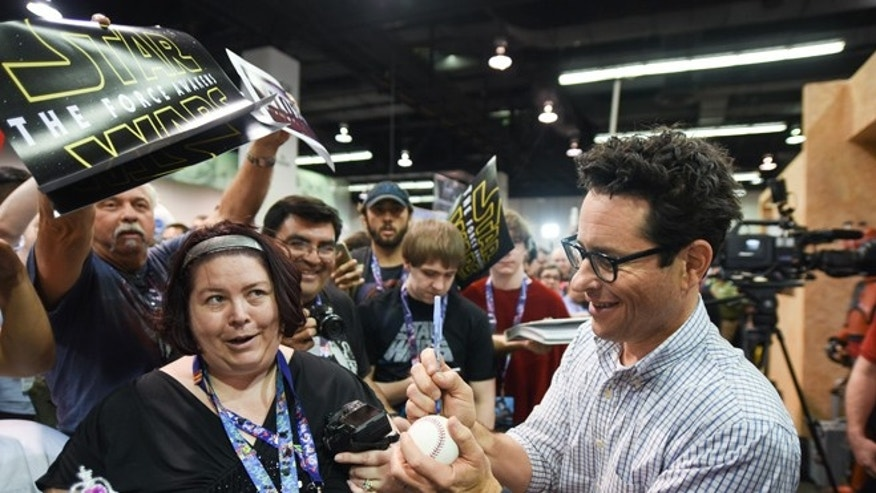 April 16, 2015. Filmmaker J.J. Abrams signs autographs for fans on the Cantina set at Star Wars Celebration: The Ultimate Fan Experience held at the Anaheim Convention Center on Thursday, April 16, 2015, in Anaheim, Calif.
