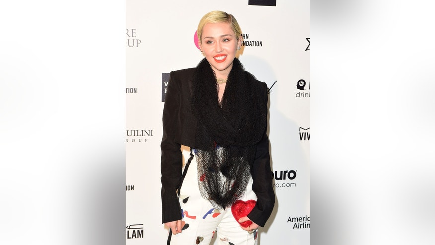Feb 22, 2015. Singer Miley Cyrus arrives at the 2015 Elton John AIDS Foundation Oscar Party in West Hollywood, California.