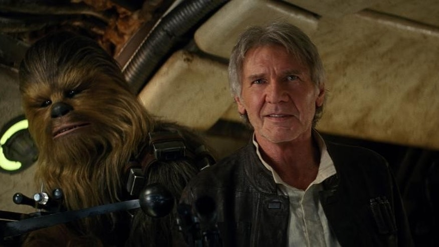 """This image released by Lucasfilm shows character Chewbacca, left, and Harrison Ford in a scene from """"Star Wars: The Force Awakens,"""" the highly anticipated film by J.J. Abrams that hits theaters Dec. 18."""