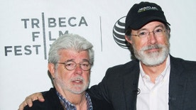 George Lucas, left, and Stephen Colbert attend the Tribeca Talks: Director Series during the Tribeca Film Festival at the BMCC Tribeca Performing Arts Center on Friday, April 17, 2015, in New York. (Photo by Charles Sykes/Invision/AP)