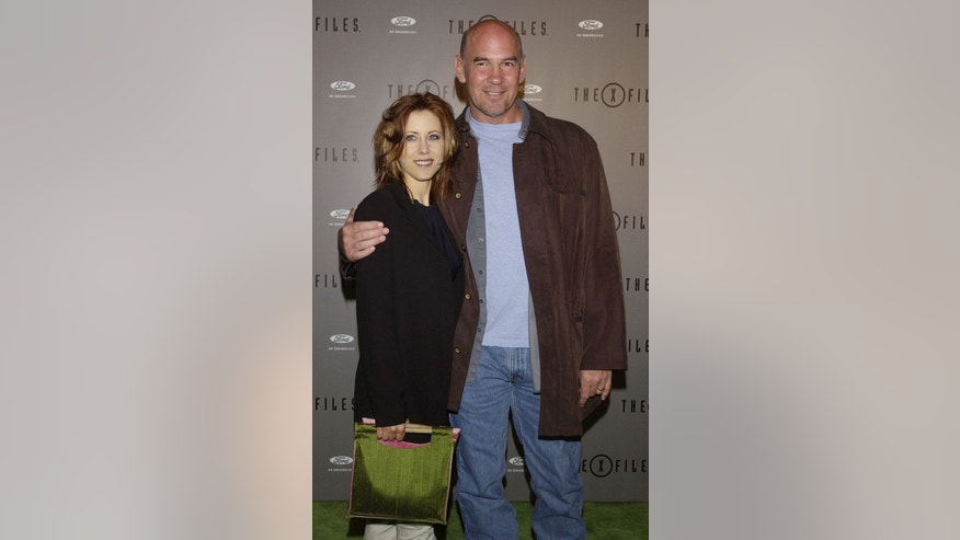 Actor Mitch Pileggi (R), poses with his wife Arlene at the House of Blues in Los Angeles, California, April 27, 2002.