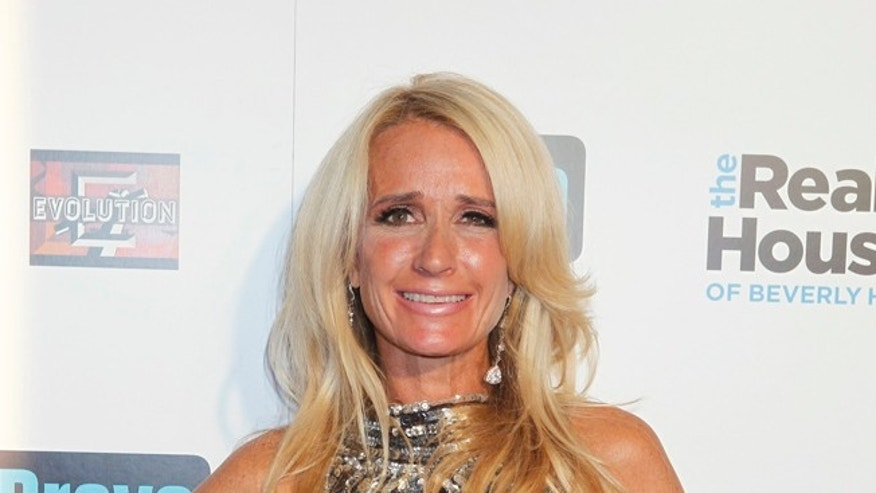 "October 11, 2010. Cast member Kim Richards of ""The Real Housewives of Beverly Hills"" poses on the red carpet at the premiere party in Los Angeles."