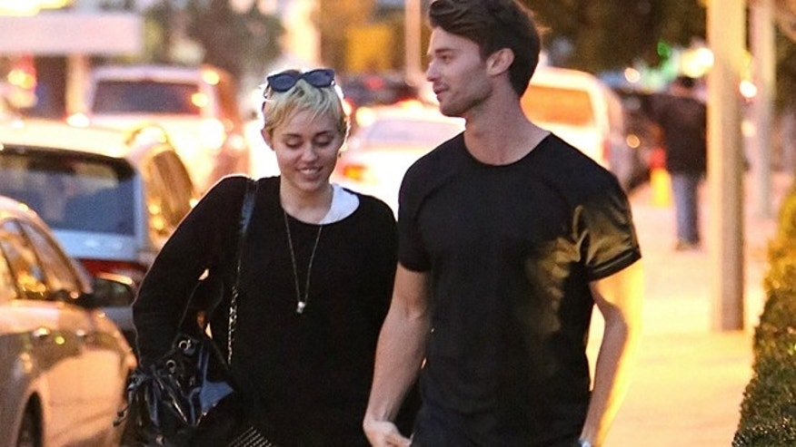 November 29, 2014. New couple Miley Cyrus and Patrick Schwarzenegger in love in Malibu during romantic outing. The couple walked the pier and went to sushi bar Nobu.