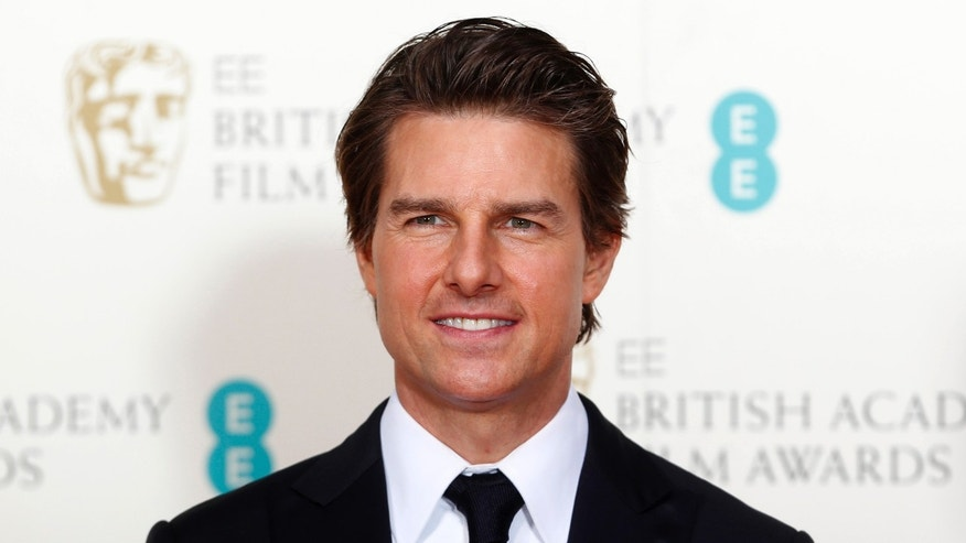 February 8, 2015. Tom Cruise poses at the British Academy of Film and Arts (BAFTA) awards ceremony at the Royal Opera House in London.