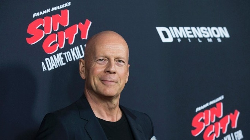 "August 19, 2014. Bruce Willis poses at the premiere of ""Sin City: A Dame to Kill For"" in Hollywood, California."
