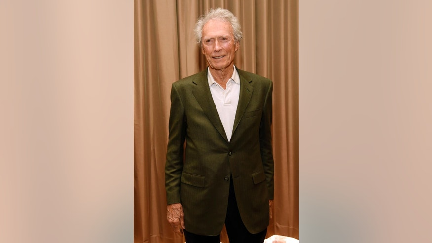 "Filmmaker Clint Eastwood poses for a photo op before ""The Legend of Cinema Luncheon: A Salute to Clint Eastwood,"" during CinemaCon 2015 at Caesars Palace on Wednesday, April 22, 2015, in Las Vegas. (Photo by Chris Pizzello/Invision/AP)"