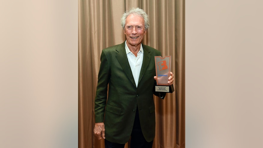 "Filmmaker Clint Eastwood holds up his Fandango Fan Choice Award for his film ""American Sniper,"" before ""The Legend of Cinema Luncheon: A Salute to Clint Eastwood,"" during CinemaCon 2015 at Caesars Palace on Wednesday, April 22, 2015, in Las Vegas. (Photo by Chris Pizzello/Invision/AP)"