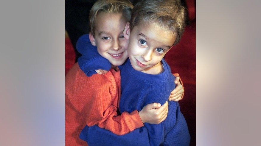 "Actors and twins Sawyer, left, and Sullivan Sweeten at the Los Angeles premiere of the movie ""Harry Potter and the Sorcerer's Stone"" on November 14, 2001."