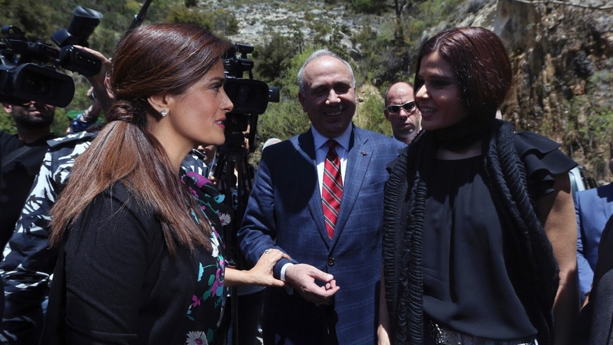 "Lebanese legislator Setrida Geagea, right, welcomes Mexican and American actress Salma Hayek, left, during her visit to Khalil Gibran's museum in the northeast mountain town of Bcharre, Lebanon, Sunday, April 26, 2015. Hayek visited her ancestral homeland Lebanon to launch her latest film ""The Prophet,"" a screen adaptation of the book by the same name written nearly a century ago by the famed Lebanese-American poet and philosopher Gibran. (AP Photo/Bilal Hussein)"
