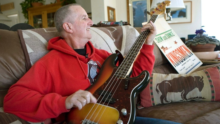 "April 16, 2009: Jack Ely, co-founder of the early 60's band The Kingsmen and best known for his 1963 rendition of the song ""Louie, Louie"", plays his Fender bass guitar at his home in Terre Bonne, Ore."