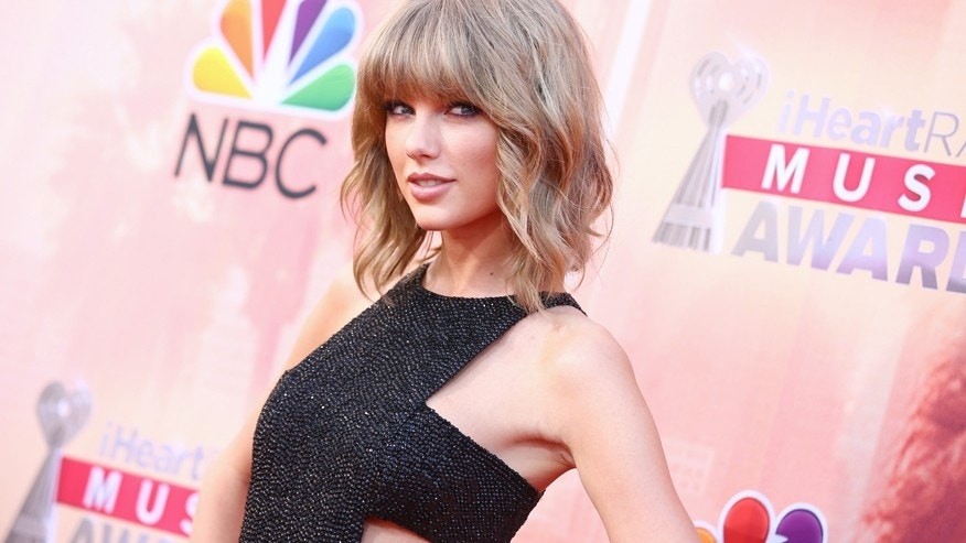 In this March 29, 2015 file photo, Taylor Swift arrives at the iHeartRadio Music Awards at The Shrine Auditorium in Los Angeles.