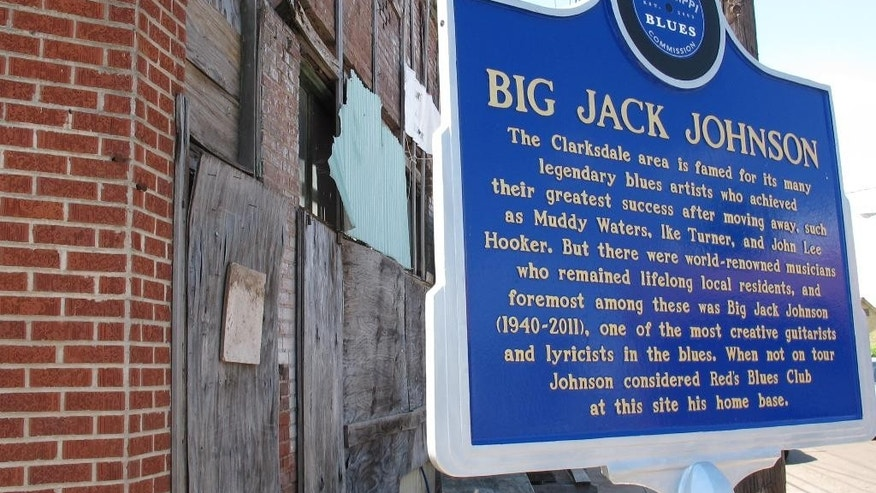 "A historical marker honors blues musician Big Jack Johnson on Thursday, April 30, 2015 in Clarksdale, Miss. Clarksdale is one of the cities included in the ""Americana Music Triangle,"" a project that seeks to promote locations that contributed to the birth of nine of America's most well-known music genres in Louisiana, Arkansas, Mississippi, Tennessee and Alabama.(AP Photo/Adrian Sainz)"