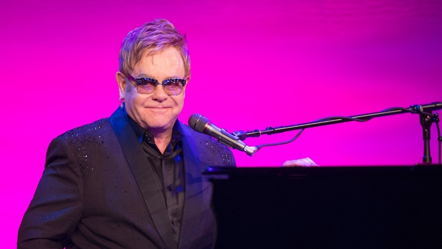 October 28, 2014. Sir Elton John performs at the Elton John AIDS Foundation's 13th annual An Enduring Vision Benefit in New York.