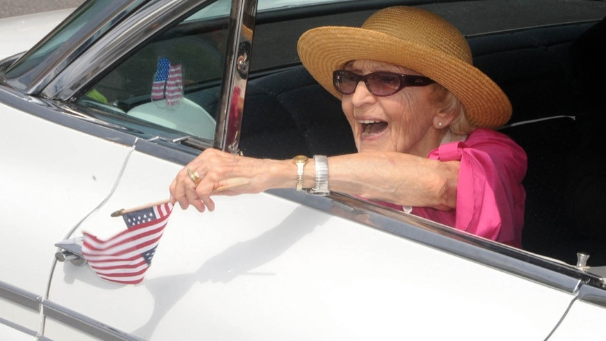 June 30, 2012: In this file photo, parade grand marshall actress Ellen Albertini Dow waves to the crowd as she rides in the back of a classic car during the Six-County Firemen's Parade in Mount Carmel, Northumberland County.