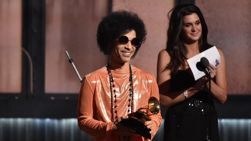 "FILE - In this Feb. 8, 2015 file photo, Prince presents the award for album of the year at the 57th annual Grammy Awards in Los Angeles. Prince has announced plans to perform at a concert in Baltimore following recent unrest in the city over the death of a man who was fatally injured in police custody. A statement issued Tuesday, May 5, 2015, says the pop icon will perform Sunday, May 10, at ""Rally 4 Peace,"" a concert at the Royal Farms Arena in Baltimore.  (Photo by John Shearer/Invision/AP)"