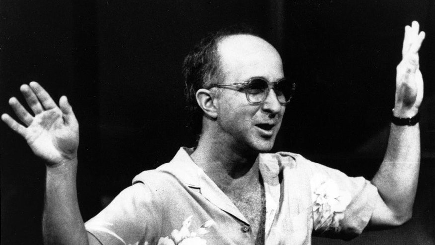 "FILE - In this July 28, 1986 file photo, bandleader Paul Shaffer directs his band during a rehearsal for ""Late Night with David Letterman"" in New York. Shaffer, now 65, has been the gravel-voiced sidekick of David Letterman since 1982. Letterman is retiring on May 20. (AP Photo/Susan Ragan, File)"