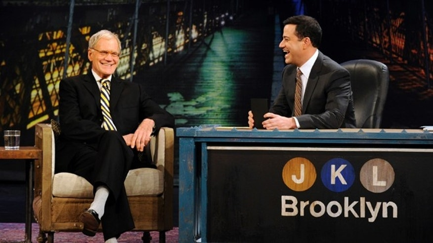 "In this Oct. 31, 2012 photo released by ABC, host Jimmy Kimmel, right, speaks with guest David Letterman during ""Jimmy Kimmel Live,"" in the Brooklyn borough of New York. New York's late-night TV hosts were back in swing, though, with all resuming regular production Wednesday. Kimmel, who usually broadcasts from Los Angeles, is doing a week of shows in Brooklyn."