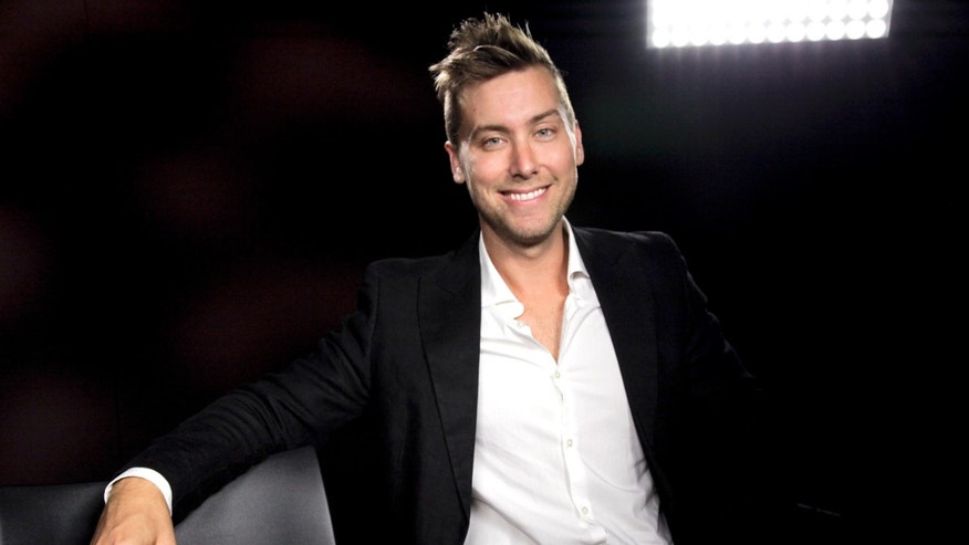 "FILE - In this July 11, 2012 file photo, pop singer Lance Bass poses for a photo during an interview in Los Angeles. Bass is hoping his new documentary, ""Kidnapped for Christ,"" will put the spotlight on unscrupulous boarding schools that abuse children in the name of  rehabilitating them. ""Kidnapped for Christ"" debuted at the Slamdance Film Festival, an alternative film festival running at the same time as the Sundance Film Festival Jan. 16-26, 2014, last week. (AP Photo/Richard Vogel, File)"