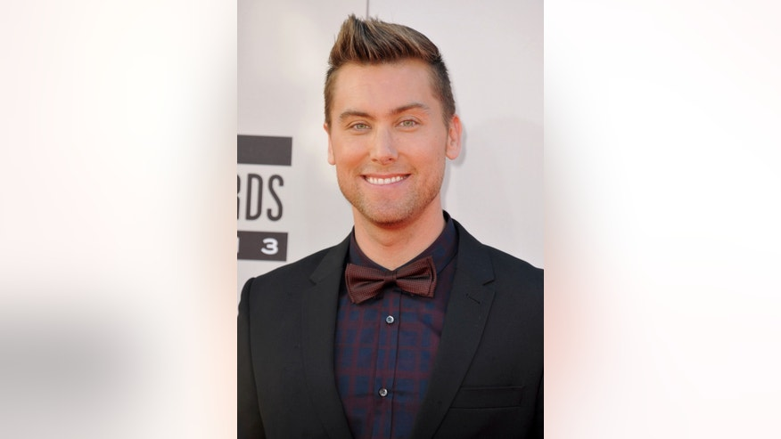 FILE - Lance Bass arrives at the American Music Awards at the Nokia Theatre L.A. Live in this Nov. 24, 2013 file photo taken in Los Angeles. If Juan Pablo Gavalis is looking for forgiveness after his comments about gays, he need look no further than Lance Bass. (Photo by Jordan Strauss/Invision/AP, File)