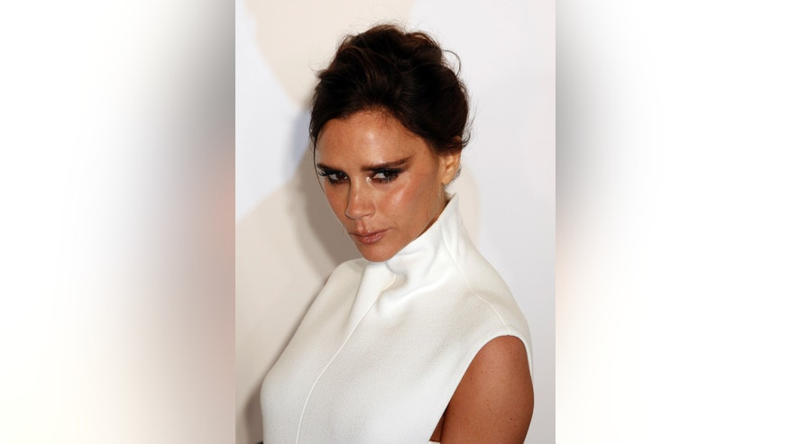 March 14, 2015. British fashion designer Victoria Beckham poses upon arrival at the Foundation for AIDS Research's (amfAR) inaugural fundraising gala in Hong Kong.