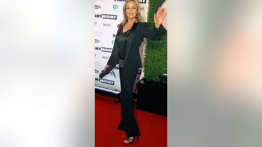 Bo Derek arrives on the red carpet at the Muhammad Ali Celebrity Fight Night Awards XIX in Phoenix, Arizona March 23, 2013. The charity event is held in honor of Muhammad Ali's fight to find a cure for Parkinson's disease, according to the organisers. Picture taken March 23, 2013.