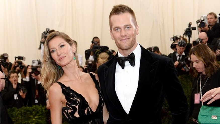 "NEW YORK, NY - MAY 05:  Model Gisele Bundchen (L) and NFL player Tom Brady attend the ""Charles James: Beyond Fashion"" Costume Institute Gala at the Metropolitan Museum of Art on May 5, 2014 in New York City.  (Photo by Dimitrios Kambouris/Getty Images)"