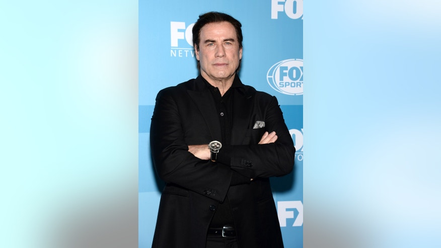 May 11, 2015. John Travolta arrives at the Fox Network 2015 Programming Upfront at Wollman Rink in Central Park in New York.