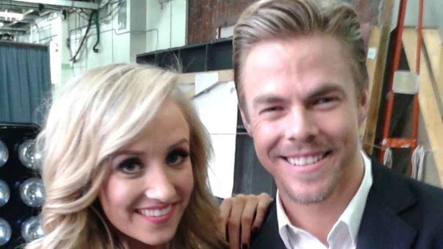 May 12, 2015: Nastia Liukin poses with partner Derek Hough after the pair were eliminated from 'Dancing With The Stars'. (Carole Glines)
