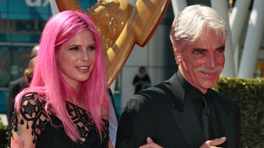 Actor Sam Elliott (R) and daughter Cleo Elliott arrive at the 65th Primetime Creative Arts Emmy Awards in Los Angeles, California September 15, 2013. REUTERS/Jonathan Alcorn (UNITED STATES - Tags: ENTERTAINMENT) - RTX13MVP