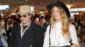 "FILE - In this Jan. 26, 2015 file photo, U.S. actor Johnny Depp and Amber Heard arrive at Haneda international airport in Tokyo to promote his latest film ""Mortdecai.""  Australian quarantine authorities have ordered Hollywood star Johnny Depp to fly his pet dogs Pistol and Boo out the country by Saturday or they will be put down. Agriculture Minister Barnaby Joyce on Thursday, May 14, 2015 accused Depp of smuggling the Yorkshire terriers aboard his private jet when he returned to Australia on April 21 to resume filming of the 5th instalment in the ""Pirates of the Caribbean"" movie series at Gold Coast studios. (AP Photo/Shizuo Kambayashi, File)"