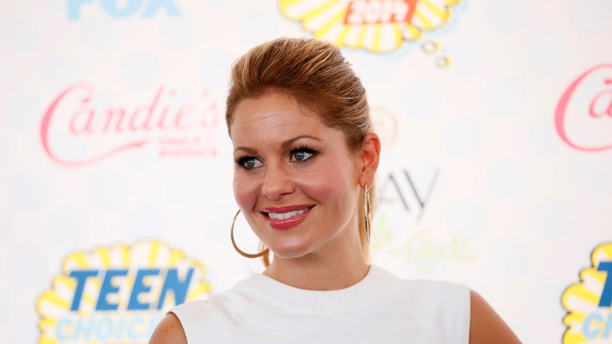 August 10, 2014. Candace Cameron-Bure arrives at the Teen Choice Awards 2014 in Los Angeles, California.