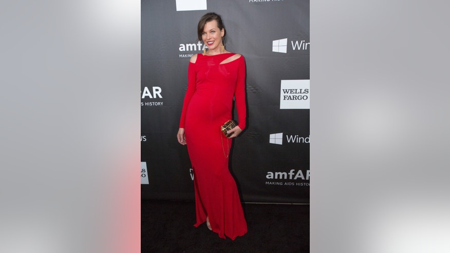 October 29, 2014. Actress Milla Jovovich poses at amfAR's Fifth Annual Inspiration Gala in Los Angeles, California.