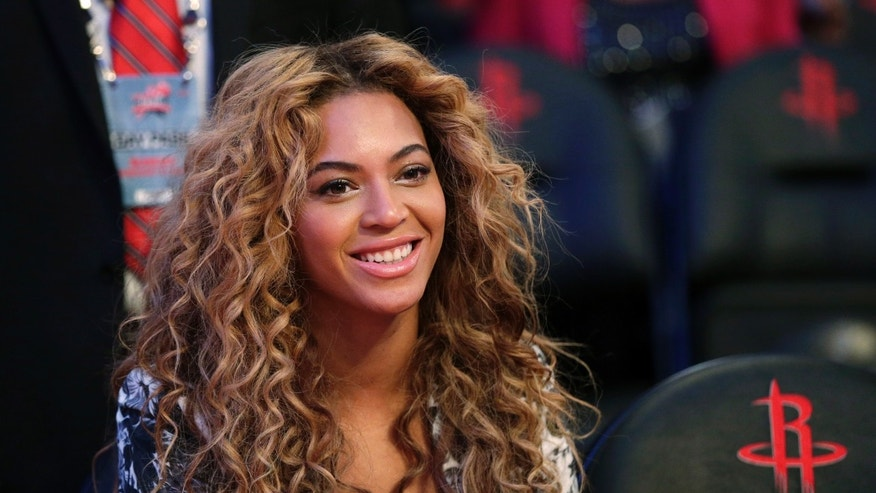 Feb. 17, 2013. Beyonce sits courtside before the NBA All-Star basketball game in Houston.