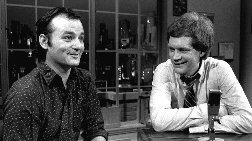 """FILE - In this Feb. 1, 1982 file photo, host David Letterman, right, and guest Bill Murray appear at the taping of the debut of """"Late Night with David Letterman"""" in New York. Murray's 44th and final appearance Tuesday, May 19, 2015, will mark the end of late-night television's most unique and enduring host-guest relationships. After 33 years in late night and 22 years hosting CBS' """"Late Show,"""" Letterman will retire on May 20. (AP Photo/Nancy Kaye, File)"""